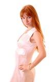 Mujer caliente joven en la alineada blanca aislada Foto de archivo libre de regalías