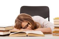 Mujer cansada con una pila de los libros Fotos de archivo libres de regalías