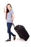 Mujer casual con la maleta grande del viaje Fotografía de archivo
