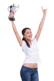Mujer casual que anima con el trofeo Fotografía de archivo