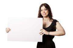 Mujer feliz aislada que lleva a cabo la muestra Fotografía de archivo libre de regalías