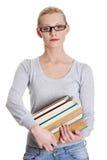 Mujer caucásica joven (estudiante) con los libros   Imagen de archivo
