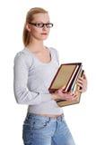 Mujer caucásica joven (estudiante) con los libros   Imagen de archivo libre de regalías
