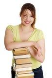 Mujer caucásica joven (estudiante) con los libros Fotos de archivo