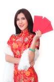 Mujer china con el bolsillo rojo por Año Nuevo chino Fotos de archivo
