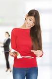 Mujer chocada del estudiante con su nota Fotos de archivo