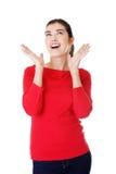 Mujer chocada que mira para arriba Fotos de archivo