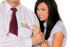 Mujer cogida tomando el dinero Imagen de archivo libre de regalías