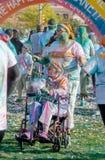 Mujer colorida en silla de rueda Fotos de archivo