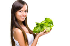 Mujer comer-hermosa saludable del ajuste que sostiene una ensalada imagenes de archivo