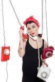 Mujer con 3 teléfonos Imágenes de archivo libres de regalías