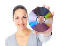 Mujer con Cd Fotografía de archivo libre de regalías
