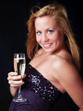 Mujer con champán del sylvester Foto de archivo
