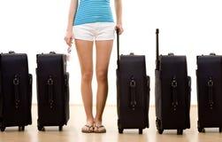 Mujer con cinco maletas Imágenes de archivo libres de regalías