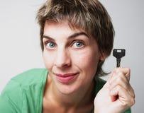 Mujer con claves Fotos de archivo