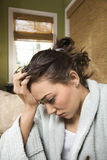 Mujer con dolor de cabeza Imagen de archivo