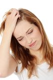 Mujer con dolor de cabeza Imagenes de archivo