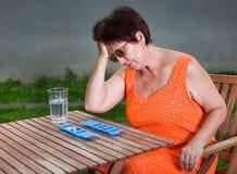 Mujer con dolor de cabeza Fotografía de archivo libre de regalías