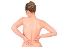 Mujer con dolor de espalda Foto de archivo libre de regalías