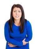Mujer con dolor de estómago Imagen de archivo libre de regalías