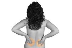 Mujer con dolor en ella detrás Fotos de archivo libres de regalías