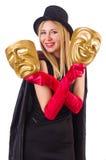 Mujer con dos máscaras Imagen de archivo