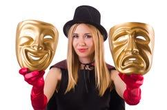 Mujer con dos máscaras Imagenes de archivo