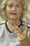 Mujer con dos mariposas Fotografía de archivo libre de regalías