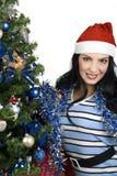Mujer con el árbol de navidad Imagen de archivo libre de regalías