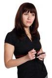 Mujer con el adminículo con la pantalla táctil. fotos de archivo