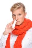 Mujer con el aerosol nasal Imagenes de archivo