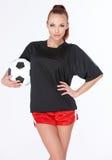 Mujer con el balón de fútbol Fotos de archivo