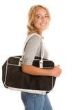 Mujer con el bolso Foto de archivo libre de regalías