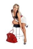 Mujer con el bolso rojo Foto de archivo libre de regalías
