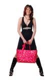 Mujer con el bolso rosado Foto de archivo