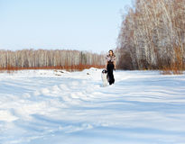 Mujer con el borzoi al aire libre Foto de archivo