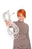 Mujer con el cable de alimentación del cable del Internet Fotos de archivo