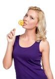 Mujer con el caramelo de azúcar Imagen de archivo libre de regalías