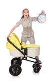 Mujer con el cochecito de niño aislado en blanco Fotos de archivo libres de regalías