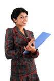 Mujer con el copyholder Imagen de archivo