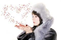 Mujer con el corazón foto de archivo