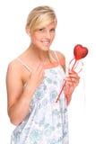 Mujer con el corazón rojo Imagen de archivo