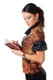 Mujer con el cuaderno Fotografía de archivo libre de regalías