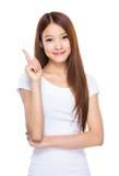 Mujer con el dedo para arriba Imágenes de archivo libres de regalías