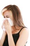 Mujer con el estornudo frío Fotos de archivo
