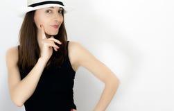 Mujer con el finger en mejilla Imágenes de archivo libres de regalías