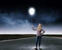 Mujer con el globo Fotos de archivo
