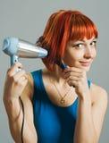 Mujer con el hairdryer imágenes de archivo libres de regalías
