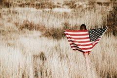 Mujer con el indicador americano Fotografía de archivo libre de regalías