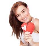Mujer con el juguete suave del corazón Imagen de archivo